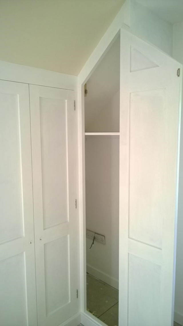 Bespoke fitted wardrobes to master bedroom and landing area with sloping ceilings 2