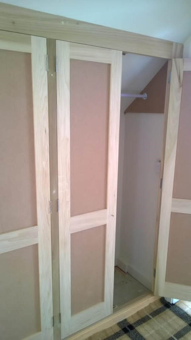 Bespoke fitted wardrobes to master bedroom and landing area with sloping ceilings 4