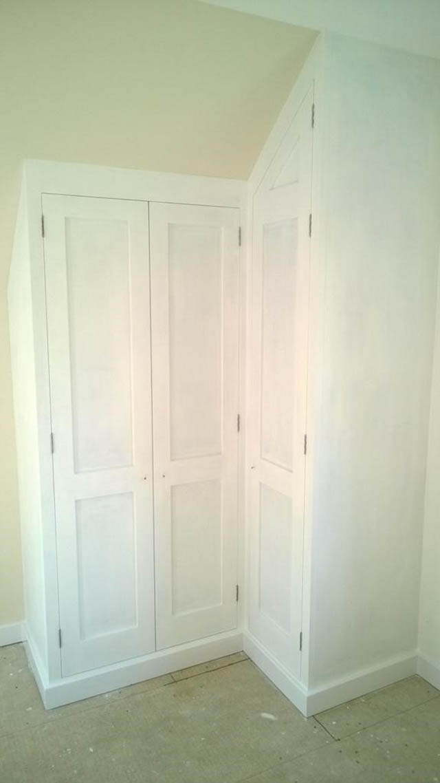 Bespoke fitted wardrobes to master bedroom and landing area with sloping ceilings 5