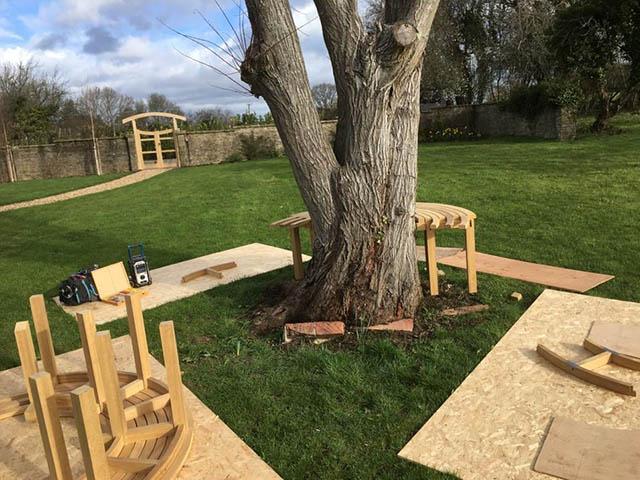 Bespoke garden seat being installed around tree in surrey