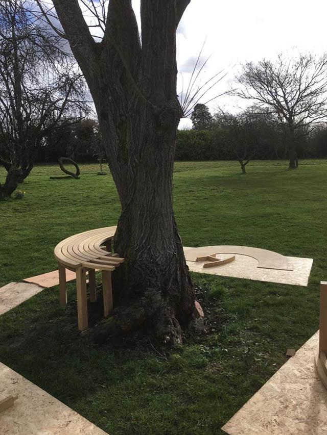 Bespoke garden seat being installed