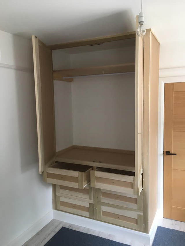 Fitted bedroom unit with top hanging and drawers below 2