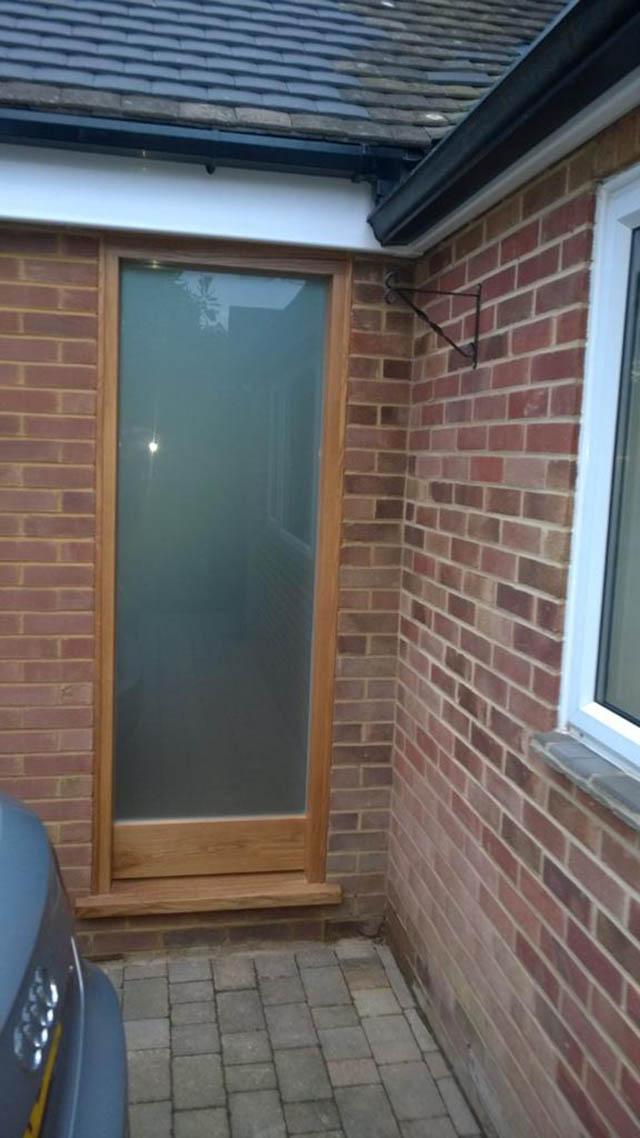 Oak entrance sidelight in Newdigate Surrey